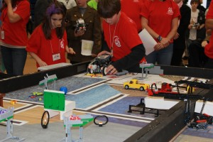 Two members of a team running their robot