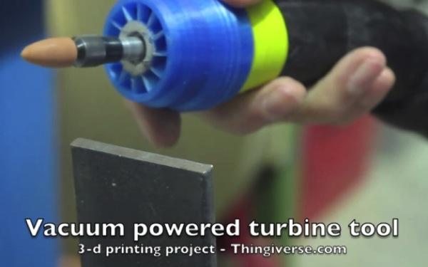Vacuum powered rotary tool
