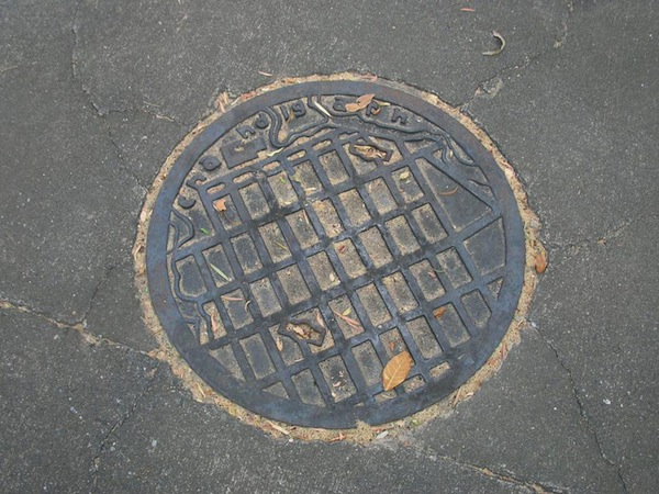 Manhole in Chandigarh, India show the grid of Corbusier's planned city streets