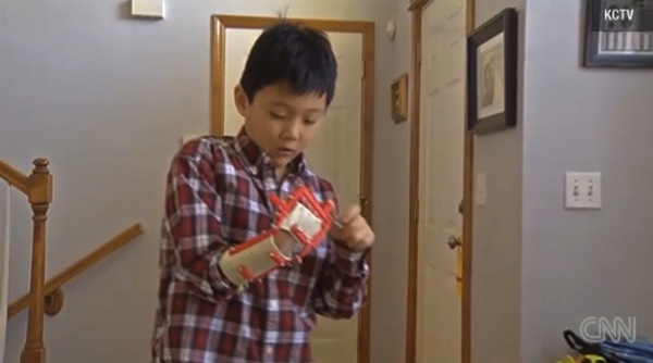 Teen prints 3 D hand for young boy