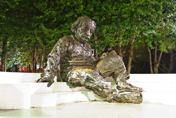 Large statue of Albert Einstein in front of the National Academy of Science in Washington, DC. You can notice the places on his lap and nose where visitors rub the oxidation from the statue.