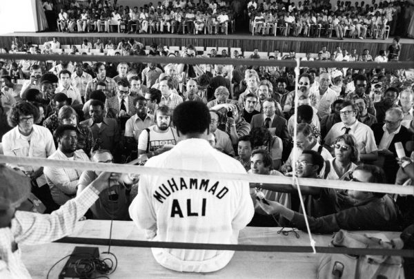 View of the press during their interview with Muhammad Ali while training before the WBC/ WBA World Heavyweight Title fight versus George Foreman at the Salle de Congres in the presidential complex outside of Kinshasa. N'Sele, Zaire 10/1974 (Image # 2042 )