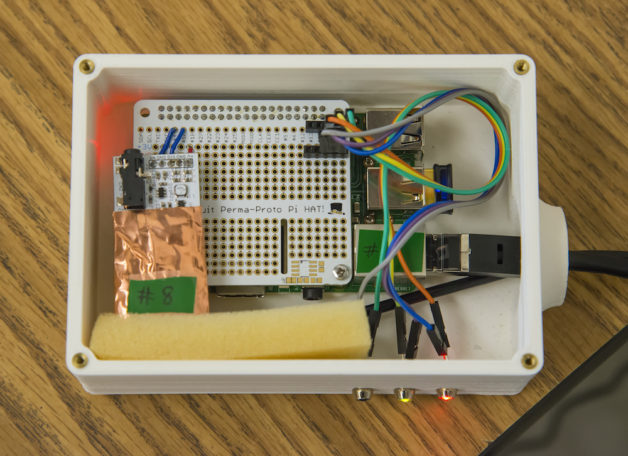 Berkeley Lab researchers involved with DoseNet, a radiation program, conducting a workshop for Campolindo High School students - installing a new dosimeter device at the school that will constantly monitor/measure background radiation.