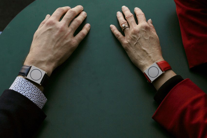 Rosalind Picard, MIT professor and chief scientist at Empatica, and Matteo Lai (L), CEO of Empatica, wear the company's Embrace devices while talking at the Massachusetts Institute of Technology in Cambridge, Massachusetts November 25, 2015. REUTERS/Brian Snyder