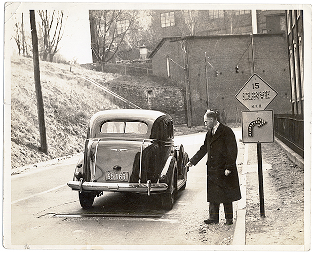 NMAH Archives Center Charles Adler, Jr., Collection  0351 Series 5 Box 12A Folder 2 Photograph; Sharles Adler Jr. demonstrating the operation of the signal by the passage of a car over the sound detector; 1936