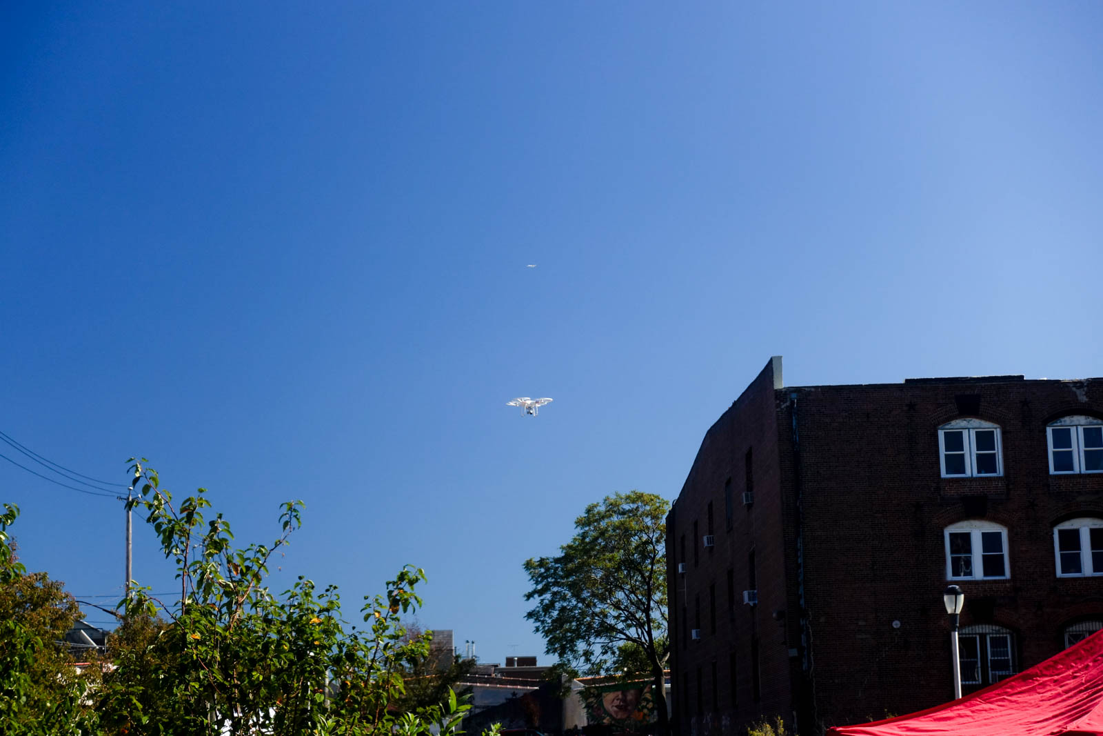 A DJI Phantom drone flew overhead recording video to be published later.