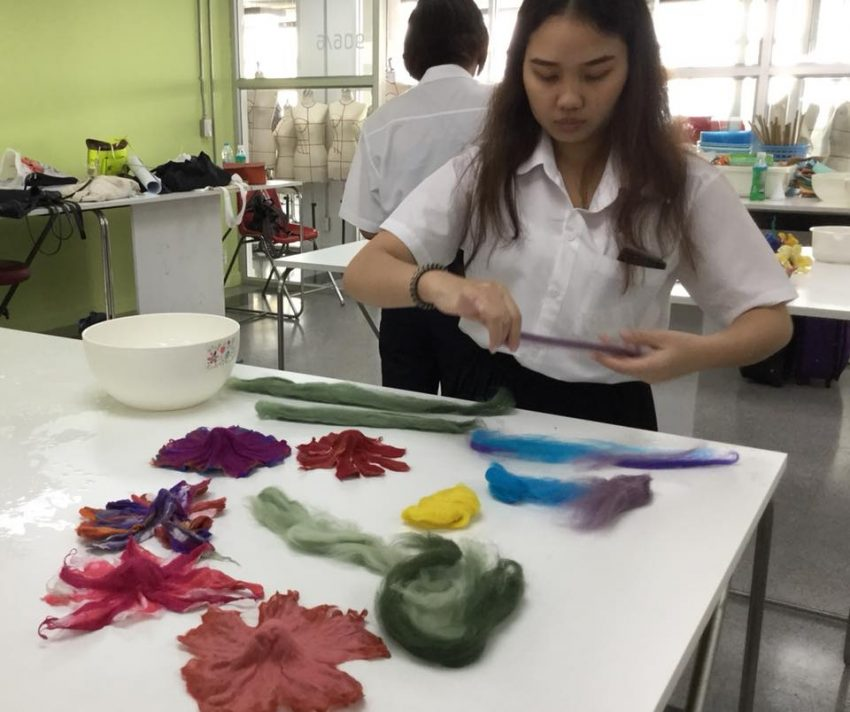 Students making felt flowers