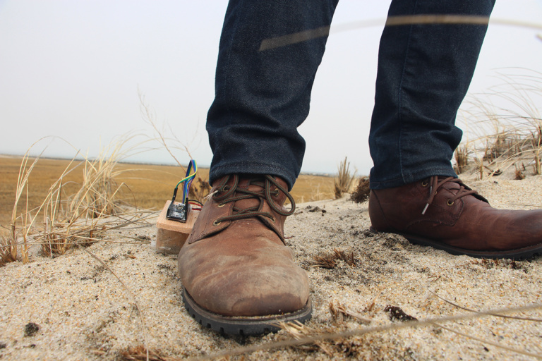 Standing on shore with a boot sensor