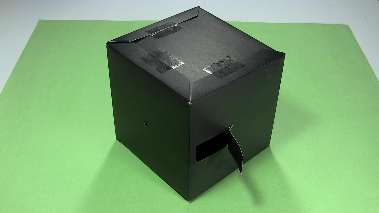 assemble a pinhole camera from a single sheet of poster board