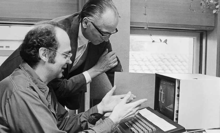 Dr. Knuth discussing typefaces with Hermann Zapf, the type designer.