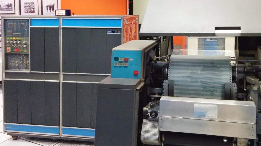 fixing the printer on a vintage IBM 1401 mainframe