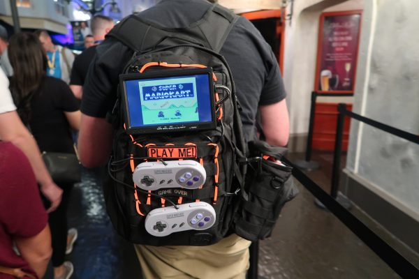 guy with a mario kart video strapped to his backpack