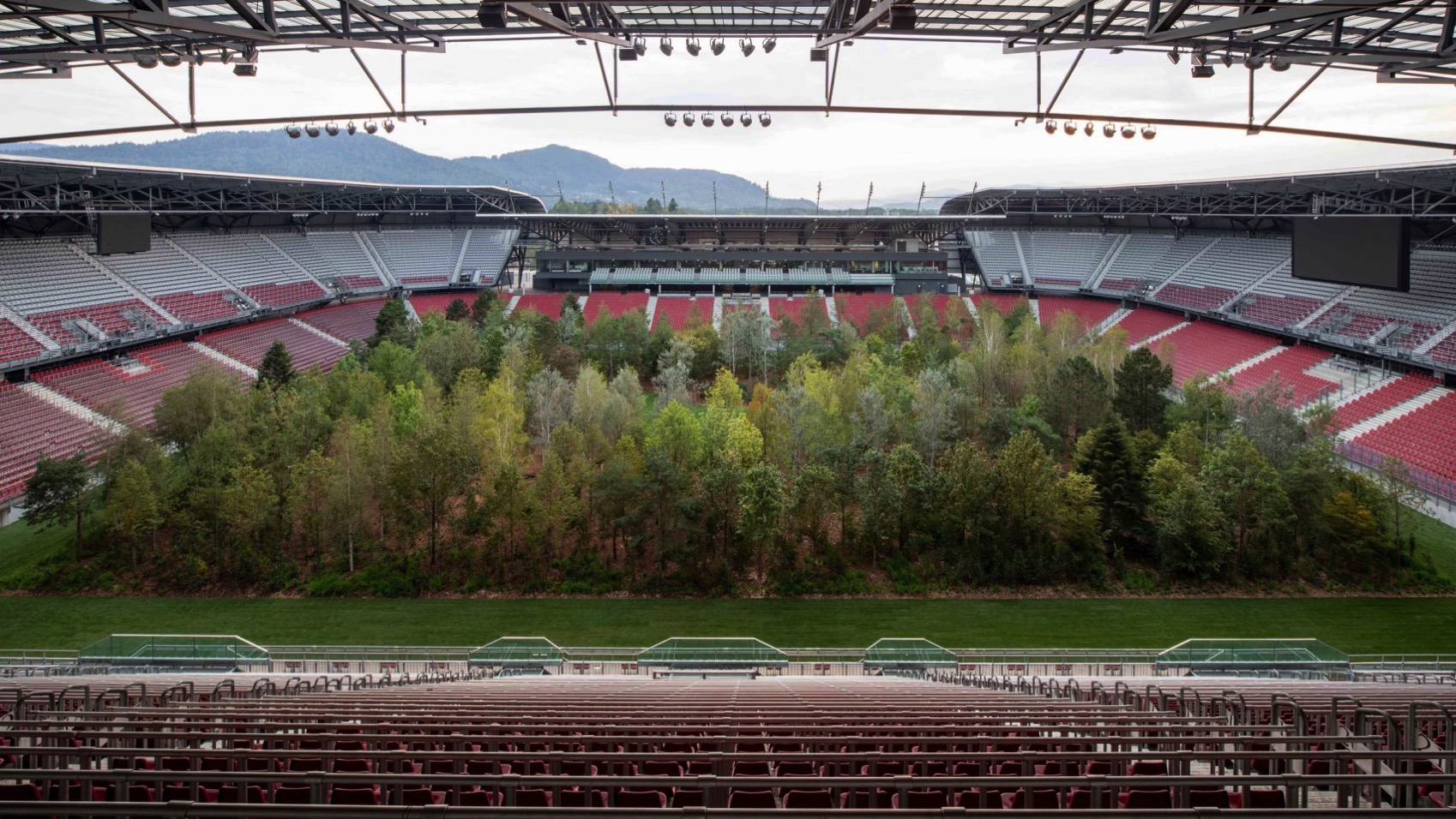 Klaus littmann for forest worthsee stadium klagenfurt photo gerhard maurer trees installation dezeen 2364 hero a 1704x959
