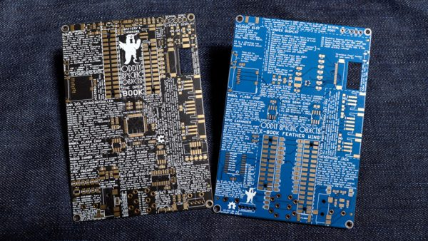 Two unpopulated circuit boards, one black and one blue, each about the size of a large index card.