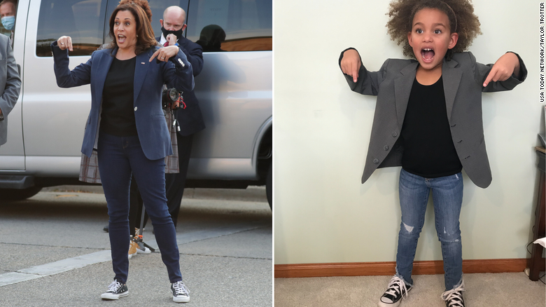 Kamal Harris on pointing at shoes mirrored on right by young girl