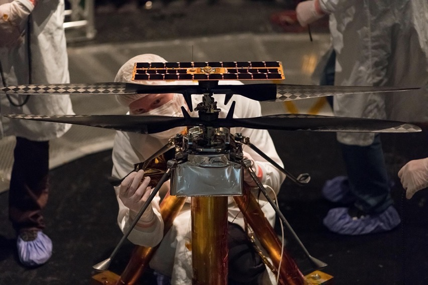 Technician works on helicopter drone