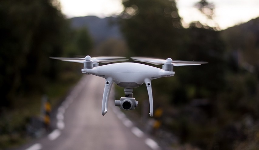 Insurance drones drone flying over road